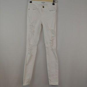 FRAME | le skinny de jeanne in ripped blanc wash